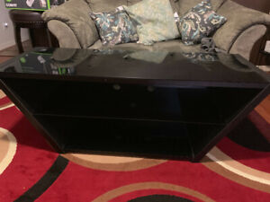 Selling real wood/glass top tv table