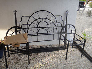 Double Black Iron Bed Frame on wheels