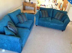 Teal three seater & two seater sofa set.