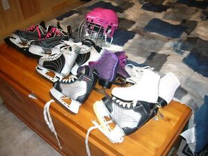 Hockey and figure skates and girl helmet