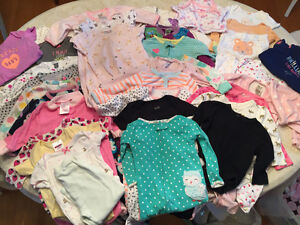 A mix of 6 Month 6 to 9 Month onesies and sleepers