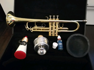 King trumpet with case, 3 mutes, oil, grease and books