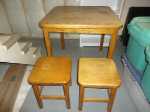 SOLID OAK TABLE AND 2  OAK STOOLS