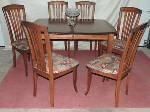 REDUCED! Solid wood dining set with leaf insert & six chairs