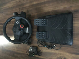 LOGITECH DRIVING FORCE GT RACING WHEEL AND FOOT PEDALS.