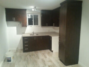 grand 3 1/2 style condos  Valleyfield demi sous-sol 8 pieds
