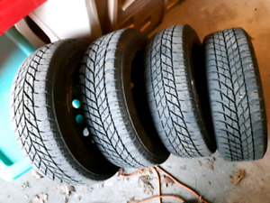 4 Goodyear 95/60R15 tires and rims ingood condition