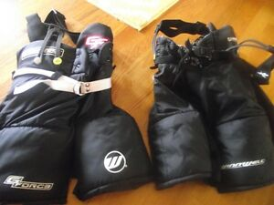 Two pairs of hockey shorts size s/m junior