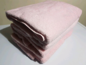 Towels and pink and orange bath mat