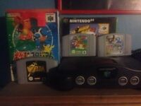 Nintendo 64 working with games, controllers and cables
