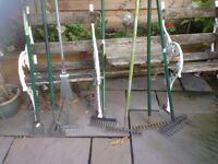Garden rakes hoes and leaf rake