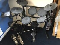 Electric drum kit and double pedals