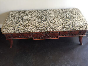 Carved elephant bench