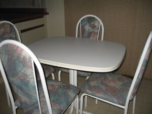 Table & 4 Chairs $60.00