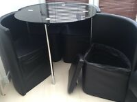 Round glass top table with 4 storage chairs