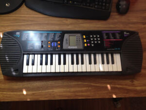 Casio SA-65 SongBank -100-Tones Electronic Keyboard & AC Adapter