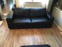 Black leather effect sofa