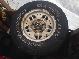 """15"""" aluminum rims off a 93 ford ranger 4 by4. Tires are worn out"""