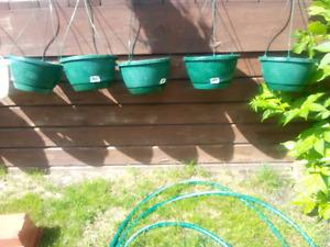 Five matching hanging pots