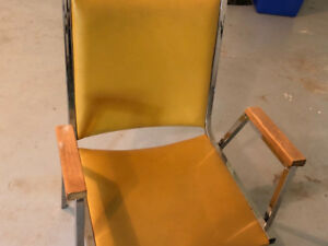 Metal chair with mustard yellow vinyl upholstery for seat and ba