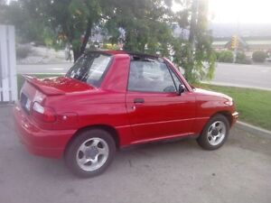 STOLEN RED 1997 SUSUKI SIDEKICK X90