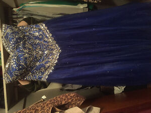 **TWO GRAD DRESSES FOR SALE**
