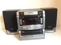 Sharp 3 disk cd changer hiding stereo