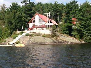 REDUCED - Beautiful off-grid lakefront home on Nepewassi Lake