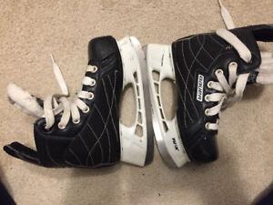 Used ice skate and helmet
