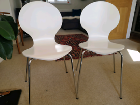 Two white dining chairs