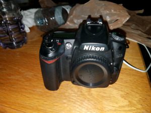 Nikon D90 Camera with charging cord, case and carrying strap