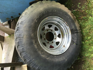 """Older ford rim with 35"""" tire"""