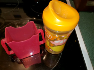 Nuby sippy cup with plug and juicebox holder