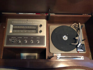 General Electric record player in wood cabinet