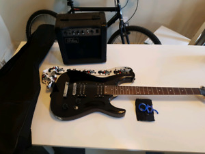 Electric guitar with amp and tuner in excellent condition.