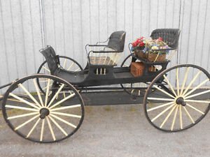 OLD TIME, 4 PASSENGER, SPINDLE SEAT TOPLESS SURRY.