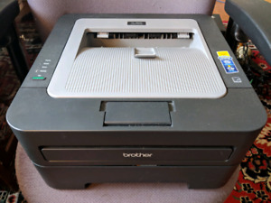 Brother Laser Printer with new toner cartridge, 2 drums- $110