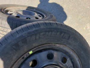 Michelin Defender XT.  225/65/R17 on Rims(sensors)