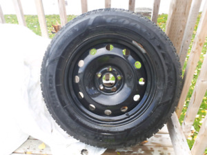 Almost new! Goodyear Ultragrip winters on rims