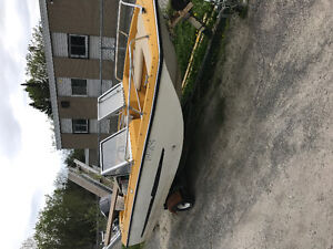 Tri hull fishing boat motor and trailer