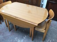 Lovely vintage Formica topped drop leaf table and two chairs