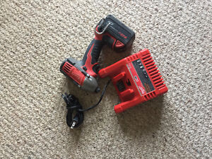 Milwaukee impact drill, one battery and charger combo