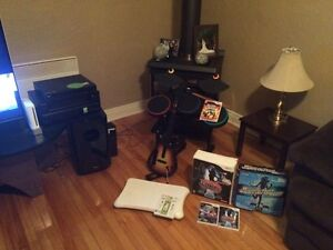 Wii console with 2controllers guitar,drums,dance mats and more