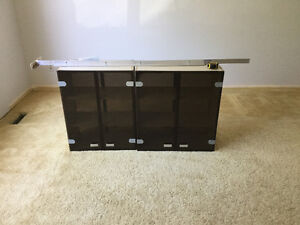 Upper double sided smoked glass cabinets