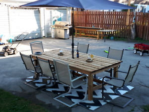 Outdoor pressure treated harvest styke picnic table.