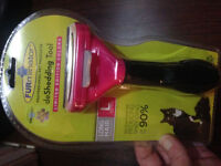 New in sealed pkg Cat Furminator for long hair