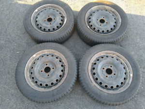 (4) Michelin X-ice tires 185/65/15 mounted on steel rims 4x114.3