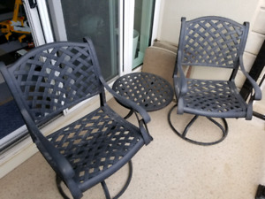 DOT cast aluminum swivel rockers and round side table