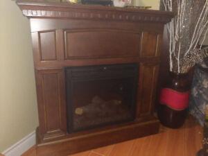 Corner electric fireplace unit.