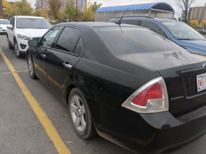 Lady- Driven Reliable Ford Fusion